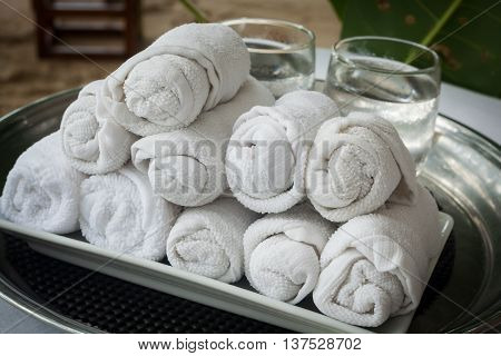 Rolled Up White Beach Towel Setup For Wedding Party