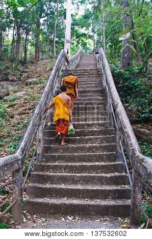 Buddhist monk walking to temple in Thailand