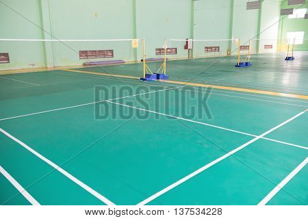 a badminton courts indoor in day time horizontal composition
