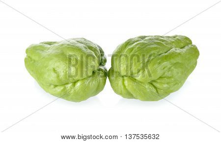 uncooked whole fresh chayote on white background