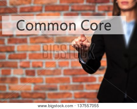 Common Core - Successful Businesswoman Making Use Of Innovative Technologies And Finger Pressing But