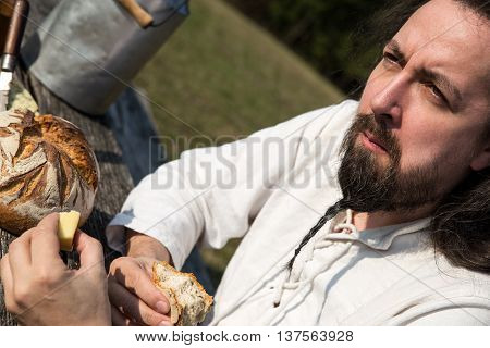Portrait Of A Bearded Man With Cheese And Bread