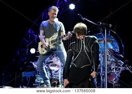 WANTAGH, NY-AUG 14: David Lee Roth (R) and Eddie Van Halen of Van Halen perform onstage at Jones Beach Theater on August 14, 2015 in Wantagh, New York.