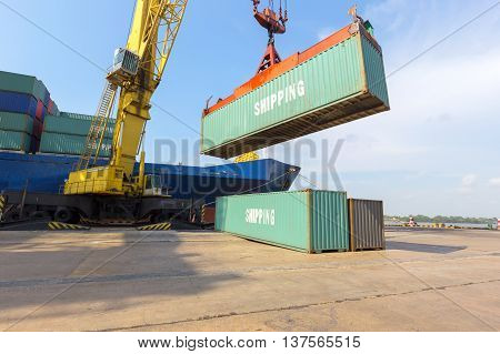 loading Containers box from Cargo freight ship with big crane