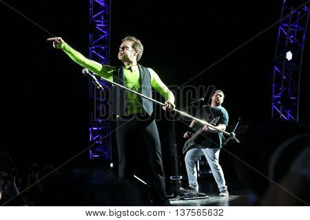 WANTAGH, NY-AUG 14: David Lee Roth (L) and Wolfgang Van Halen of Van Halen perform onstage at Jones Beach Theater on August 14, 2015 in Wantagh, New York.
