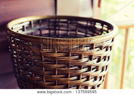 wickerwork, crafts and interior accessories concept - close up of wicker basket