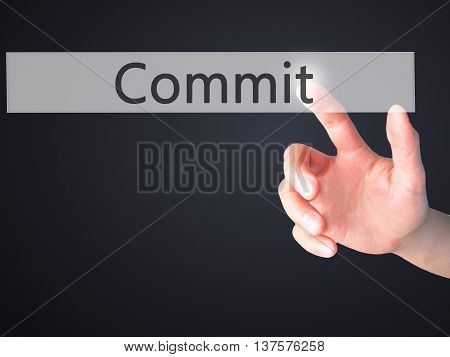 Commit - Hand Pressing A Button On Blurred Background Concept On Visual Screen.