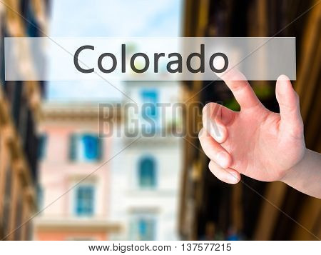 Colorado - Hand Pressing A Button On Blurred Background Concept On Visual Screen.