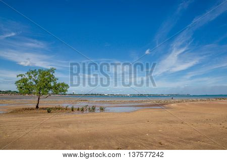 Beach at Darwin Australia with city in the distance