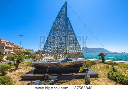 An iron sculpture with on background the promontory of Gibraltar in a sunny day, seen from La Linea de la Concepcion, Spanish town of Andalusia bordering the frontier of Gibraltar, British territory.
