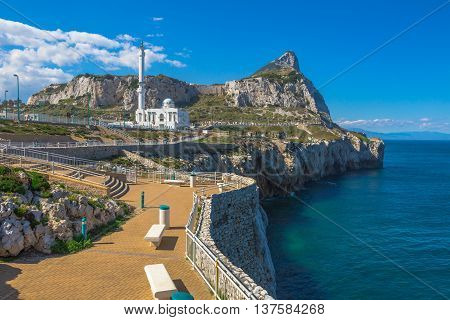 Europa Point with Ibrahim-al-Ibrahim Mosque and the profile of Gibraltar Rock. Europa Point is the southernmost point of Gibraltar, a territory of South West Europe which is part of the United Kingdom.