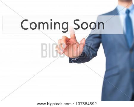 Coming Soon -  Businessman Click On Virtual Touchscreen.