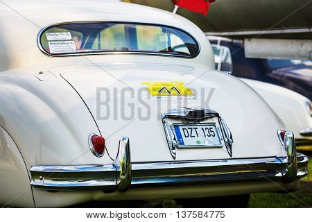 MINSK BELARUS - MAY 07 2016: Close-up of white Jaguar Mk VIII. This classic car was produced in the years 1956-1958. Back view of retro vintage auto. Selective focus.