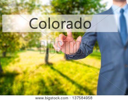 Colorado -  Businessman Click On Virtual Touchscreen.