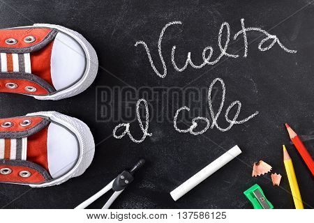 Vuelta Al Cole Written On A Blackboard With Tools