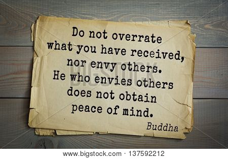 Buddha quote on old paper background. Do not overrate what you have received, nor envy others. He who envies others does not obtain peace of mind.