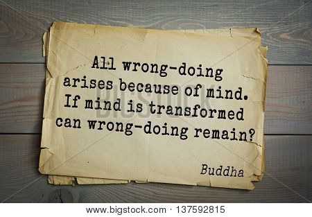 Buddha quote on old paper background. All wrong-doing arises because of mind. If mind is transformed can wrong-doing remain?