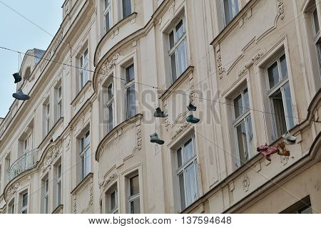 Shoes hung on a rope across the street