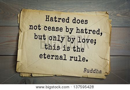 Buddha quote on old paper background. Hatred does not cease by hatred, but only by love; this is the eternal rule.