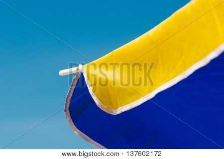 Close up from a colord parasol with blue sky