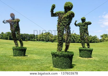 Topiary Garden Sculpture made of grass - man figure. Eco and nature concept
