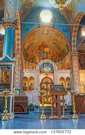 BATUMI GEORGIA - MAY 24 2016: The colorful murals on the apse of St Nicholas Church and the carved stone iconostasis on May 24 in Batumi.