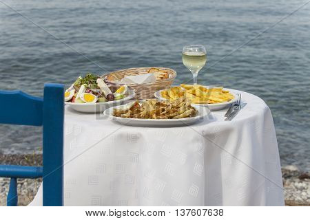 greek food outdoor in summer at the sea