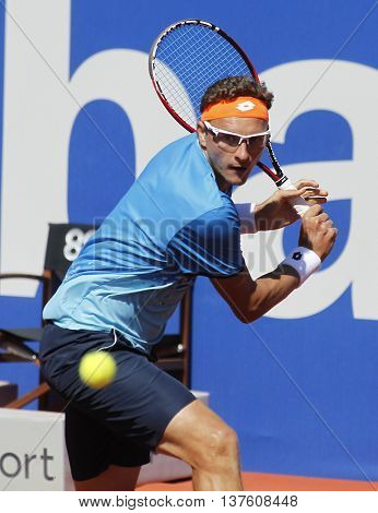 BARCELONA - APRIL,19: Uzbek tennis player Denis Istomin in action during a match of Barcelona tennis tournament Conde de Godo on April 19, 2016 in Barcelona