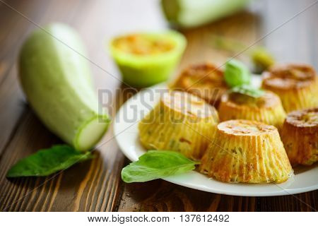 vegetable muffins with zucchini on a wooden table