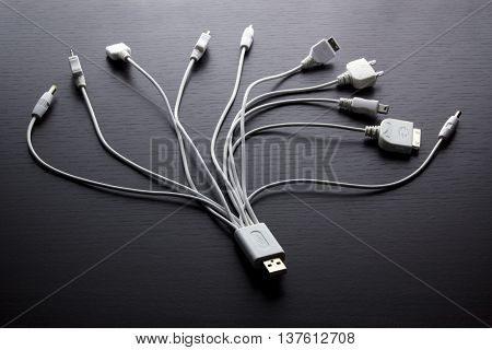 USB Multi Adaptors on Warm Wooden Background