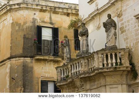 Lecce statues at the entrance piazza duomo