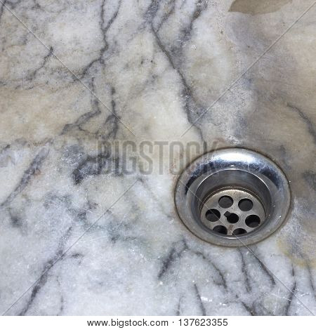 The hole water drain of basin in bathroom.