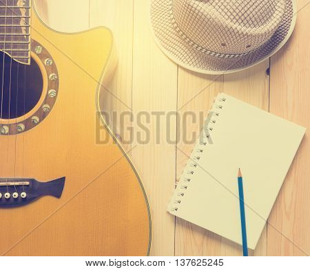 Country Music writing with guitar and cow boy hat