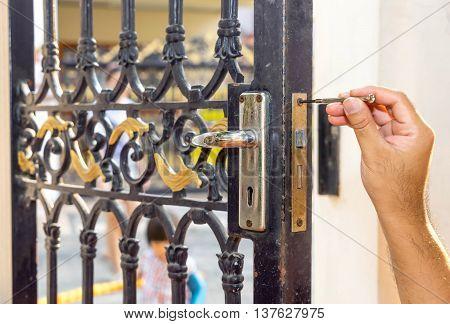 repair old steel door and locksmith hand