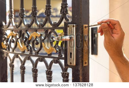 locksmith on old blue steel door for maintain