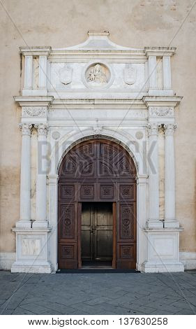 Marble portal in Gothic-Renaissance style of the cathedral in Montagnana Italy.