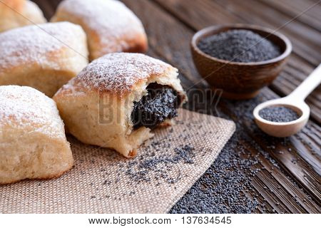 Baked yeast dumpling with poppy seed filling