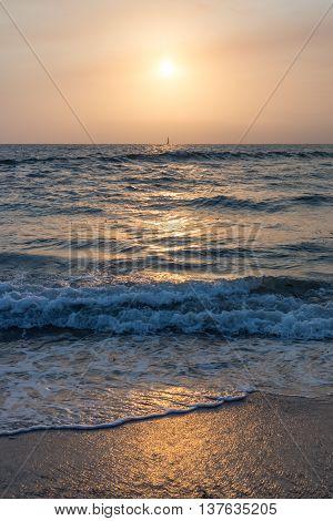 The Sun Slowly Setting at the Beach