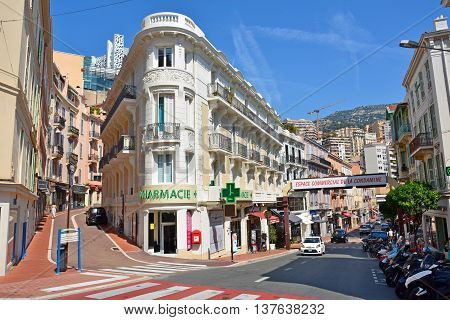 Monaco, Monaco - July 11, 2015. Street view on the intersection of Rue Grimaldi and Rue de la Turbie in Monaco, with buildings, city traffic and people.
