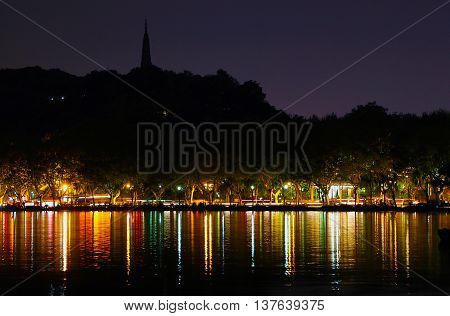 Westlake night light reflection by Baoshi Mountain, Hangzhou, China