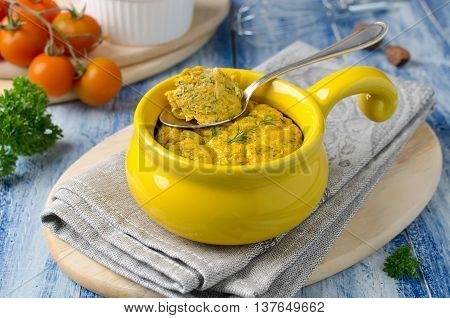 French baked cheese souffle with carrots and dill in white ramekin. Delicious and healthy Breakfast for the whole family
