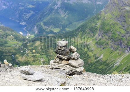 Stones laid by tourists to commemorate the visit of the Trollstigen road, Norway.