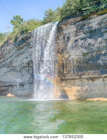 Spray Falls rainbow at Pictured Rocks National Lakeshore, near Munising, Michigan. Mineral seepage creates the colors: Red and orange are iron, green and blue are copper, black is manganese and white is lime.