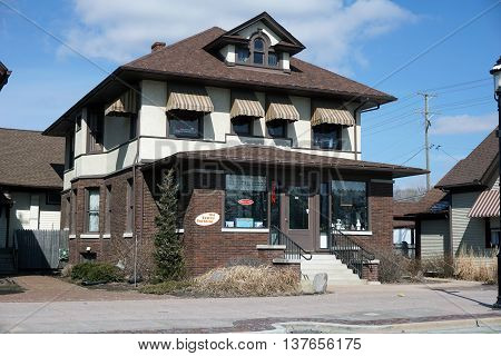 PLAINFIELD, ILLINOIS / UNITED STATES - DECEMBER 29, 2015: One may purchase gifts, dolls, and specialty foods at the Tawny Tortoise in downtown Plainfield.