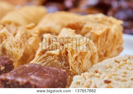 Oriental sweets on a white plate. Turkish or greek delight