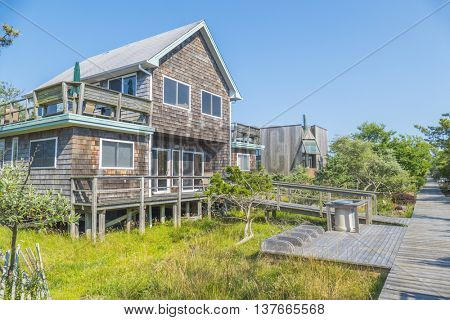 OCEAN BEACH, FIRE ISLAND, US, JULY 6, 2016: Typical house and wooden path