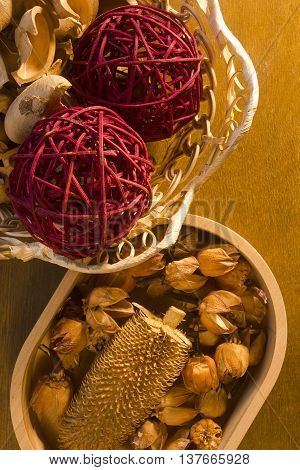 Colorful assorted potpourri in a wicker basket on a wooden table poster