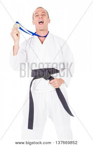 Portrait of fighter holding gold medal and screaming aloud on white background