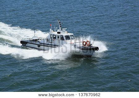 Busan South Korea - June 2th 2016: Busan anchorage of sea vessels a pilotage boat on full speed.
