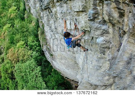 male rock climber. rock climber climbs on a rocky wall
